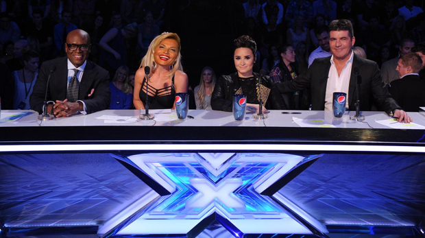 THE X FACTOR: TOP 8: L-R: L.A. Reid, Britney Spears, Demi Lovato and Simon Cowell live on THE X FACTOR, Wednesday, November 28 (8:00-9:00 PM ET/PT) on FOX. CR: Ray Mickshaw / FOX.