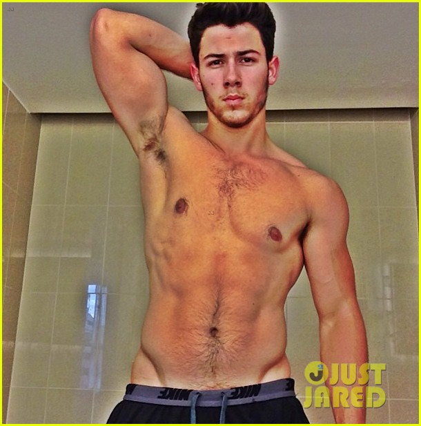 nick-jonas-goes-shirtless-in-buff-post-workout-photo-03