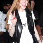 Lindsay-Lohan-jovial-mood-flashing-peace-sign