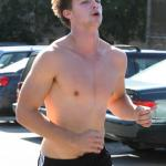 Patrick Schwarzenegger seen doing exercise with his personal trainer in Brentwood, CA on Saturday