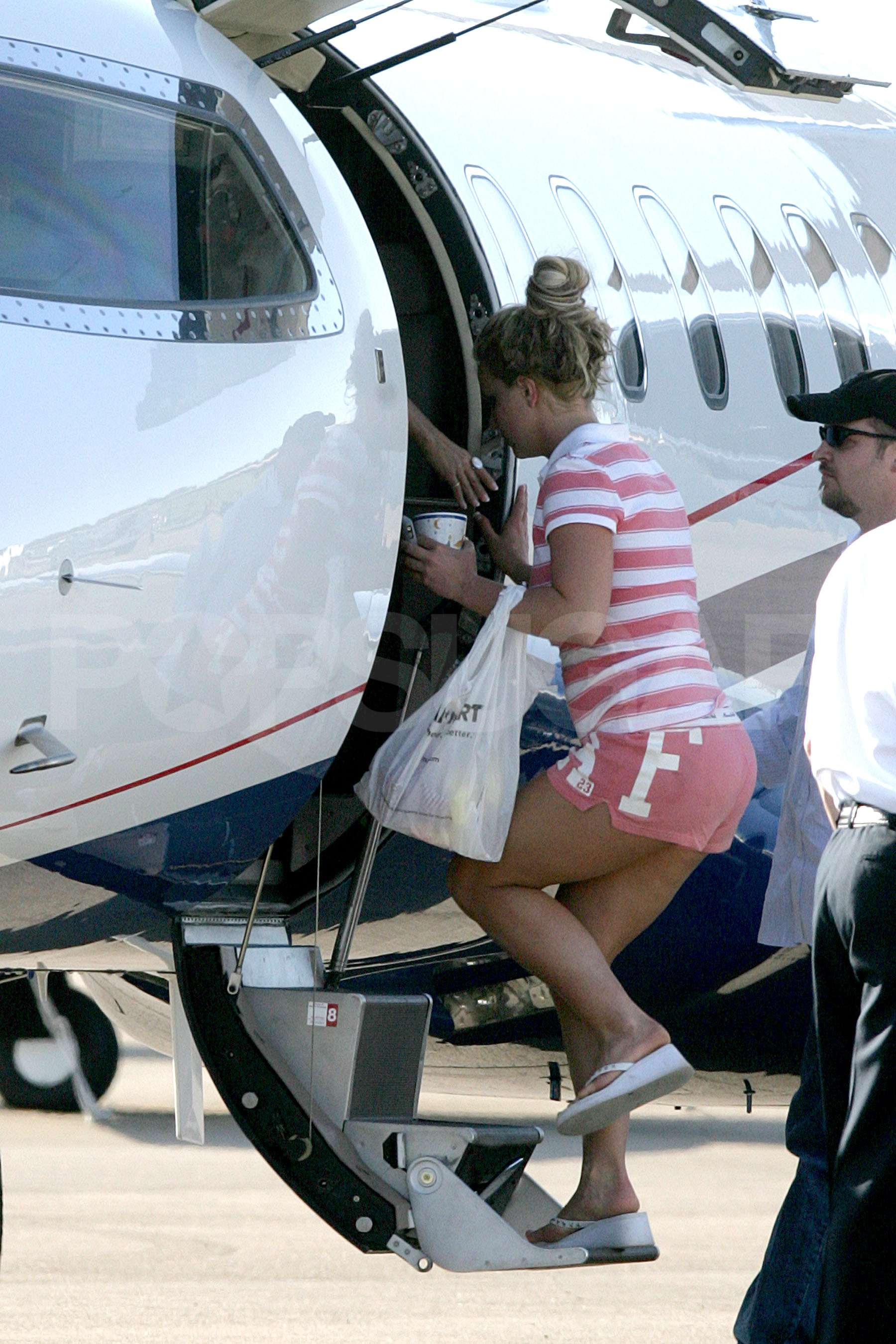 Britney Spears boards a private jet with her mother, Lynn and father, Jamie at a private airport in Mississippi.
