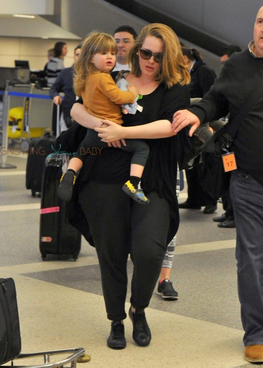 Singer-Adele-and-her-son-Angelo-Konecki-arriving-on-a-flight-at-LAX-536x750