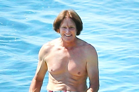Olympian Bruce Jenner does paddleboard shirtless in Greece with his two sons