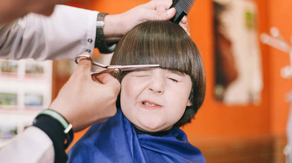 Boy (5-7) having haircut