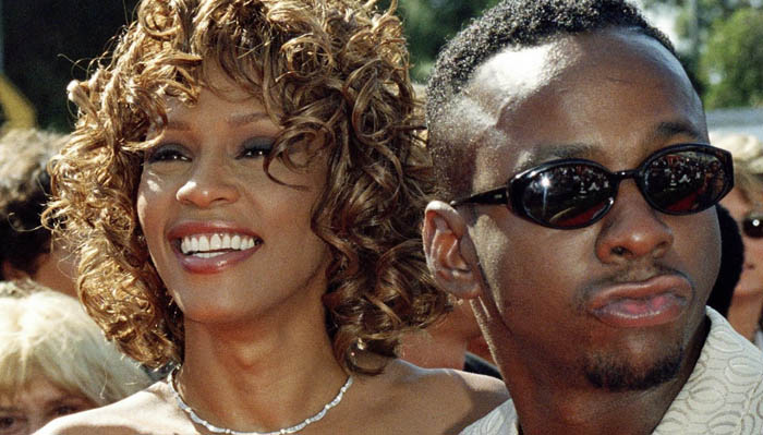 THE 50TH ANNUAL PRIMETIME EMMY AWARDS -- Pictured: (l-r) Singer/actress Whitney Houston, husband singer Bobby Brown on the red carpet at the 50th Annual Primetime Emmy Awards held at the Shrine Auditorium in Los Angeles, CA on September 13, 1998 -- Photo by: Margaret Norton/NBCU Photo Bank
